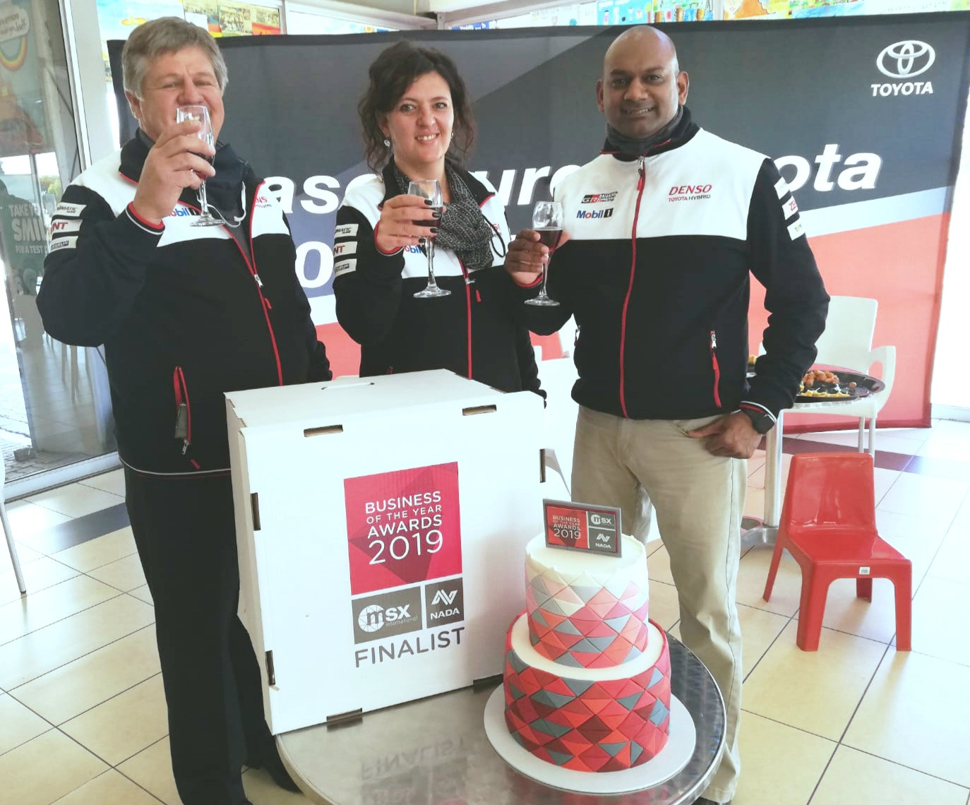 Hannes Strydom (Dealer Principal at Vaal Toyota Sasolburg), Zarlene Hugo (Sales Manager) and Dezesh Simunger (After-sales Manager) celebrating winning the award.